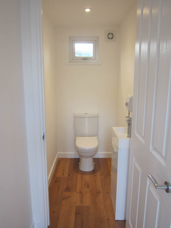 The garden room has a cloakroom with toilet & basin