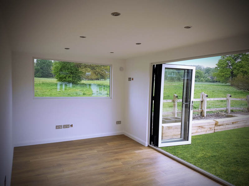 Incorporating two sets of doors floods this garden room with light