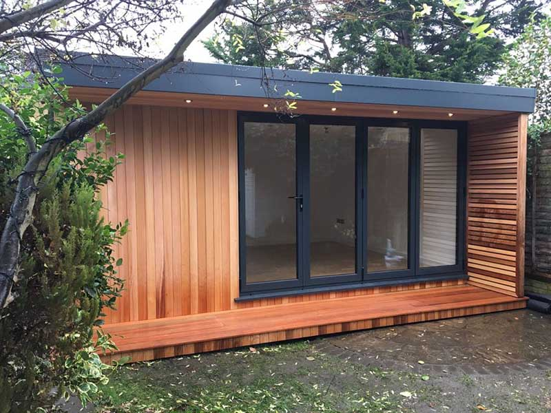 Cedar clad ballet studio with bi-fold doors