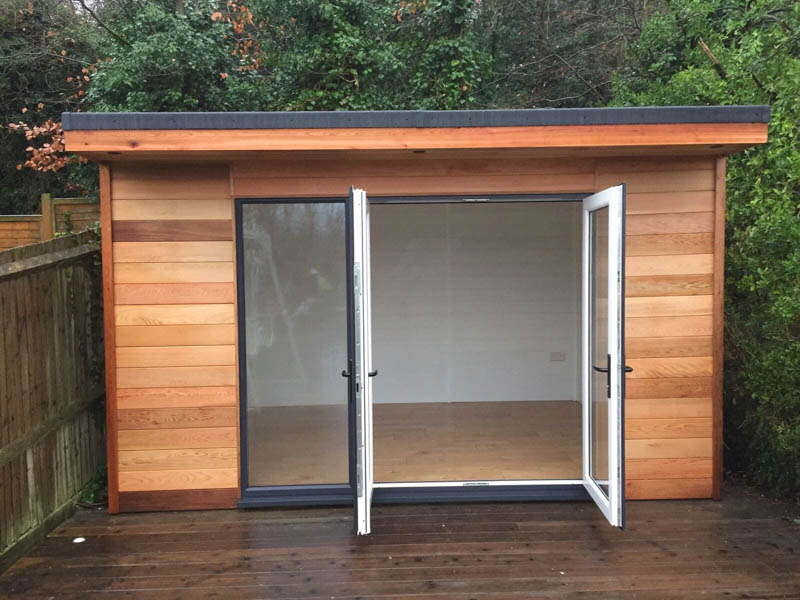 This standard design garden room has French doors