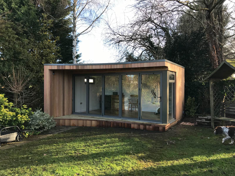 The garden room features a wrap around corner of doors and windows