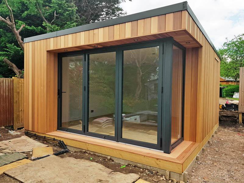 The corner of glazing has been created with bi-fold doors and a fixed window