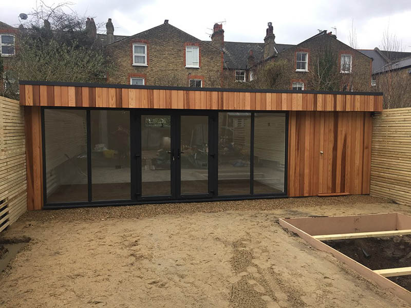 The garden room slots in tight to three boundary fences