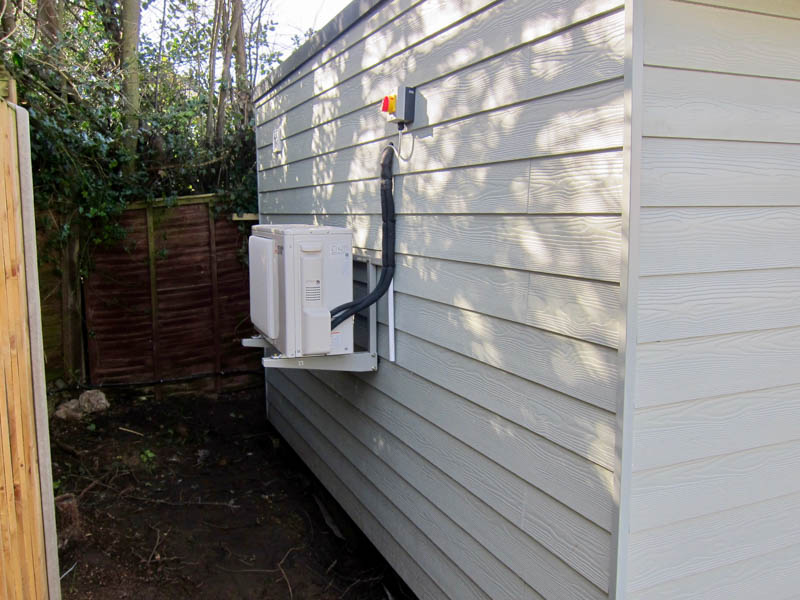 The external unit of the air conditioning system can be positioned out of sight on a side wall