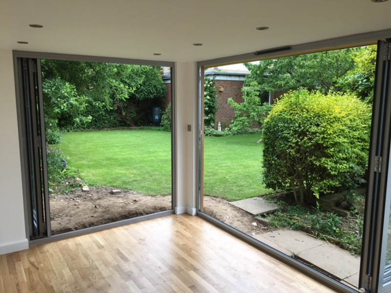 Two sets of bifold doors on an eDEN Garden Room
