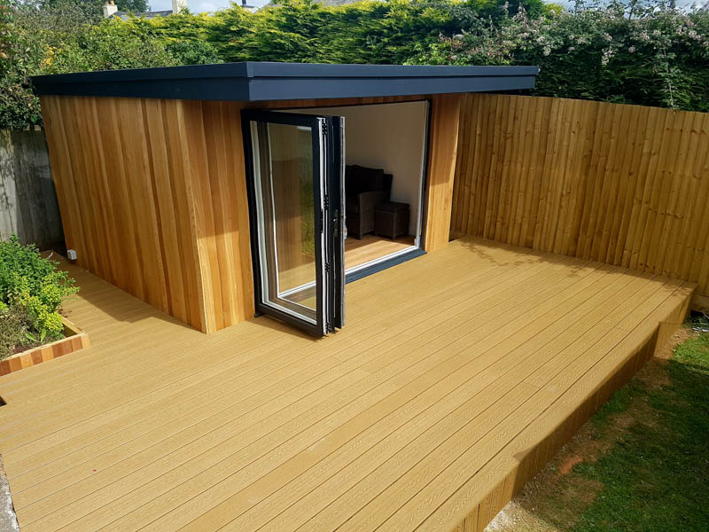 Cedar garden room with composite decking