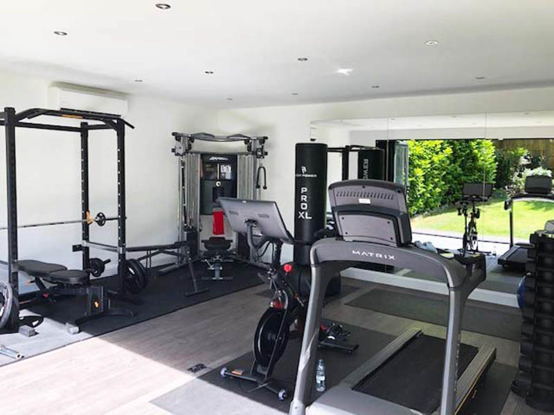 Mirrors make the reflect the bi-fold doors in the gym