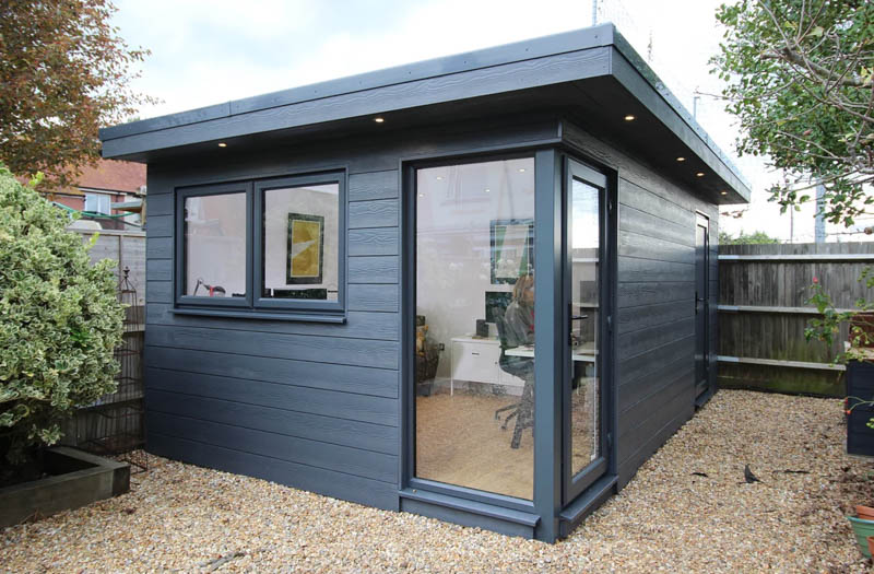 Garden office with bike store by Timber Rooms
