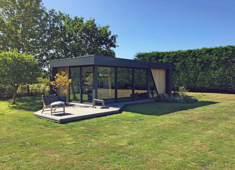 Large garden room with composite decking by Swift Garden Rooms