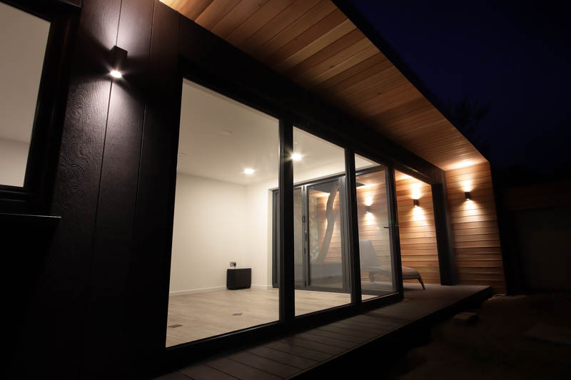 Cedar cladding mixed with Millboard composite wood