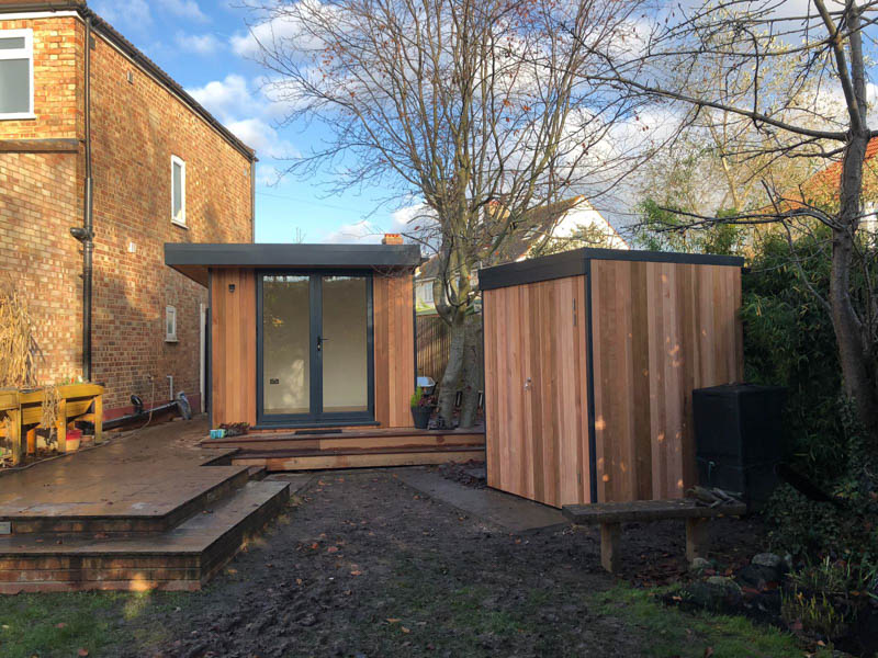 Cedar garden office with matching mini shed