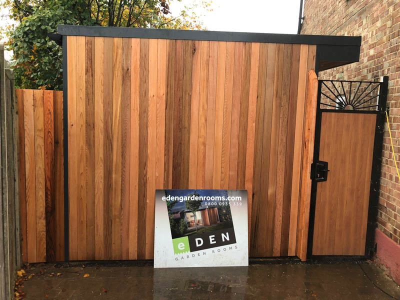 The Cedar cladding and gate disguises what lies beyond.