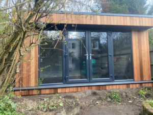 Cedar clad home office / yoga studio with shower room by Garden Spaces
