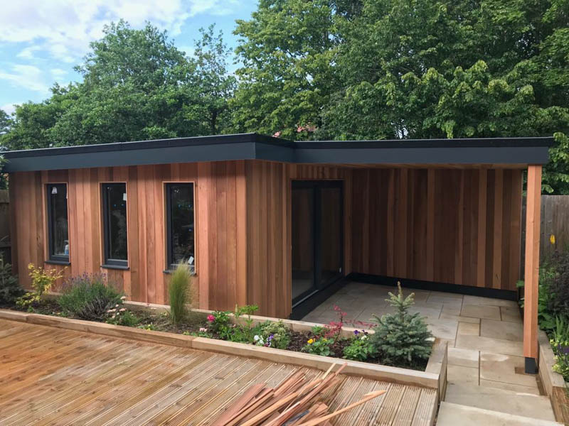 Cedar garden room with side canopy area by Bridge Garden Rooms