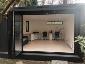 Black clad garden rooms by Ark Design Build