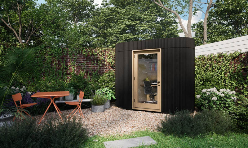 Micro garden office that sits comfortably in the corner of the garden