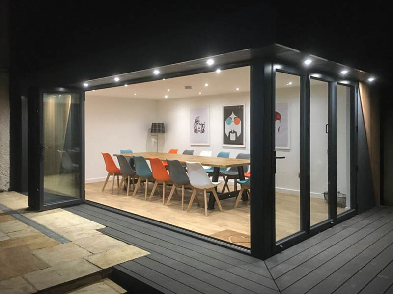 Outdoor entertainment room by Swift at night
