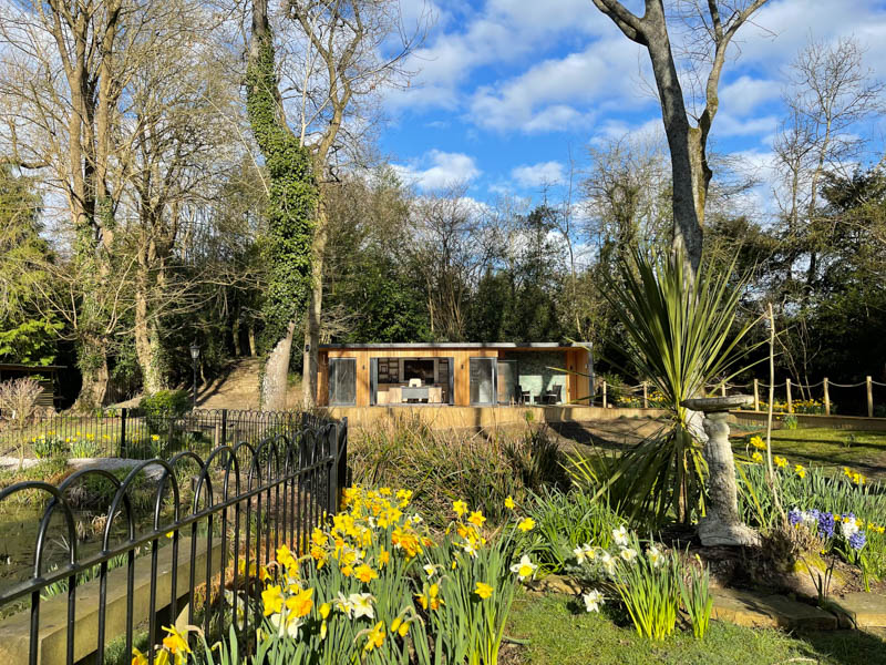 Bespoke garden office with outdoor seating area by A Room In The Garden