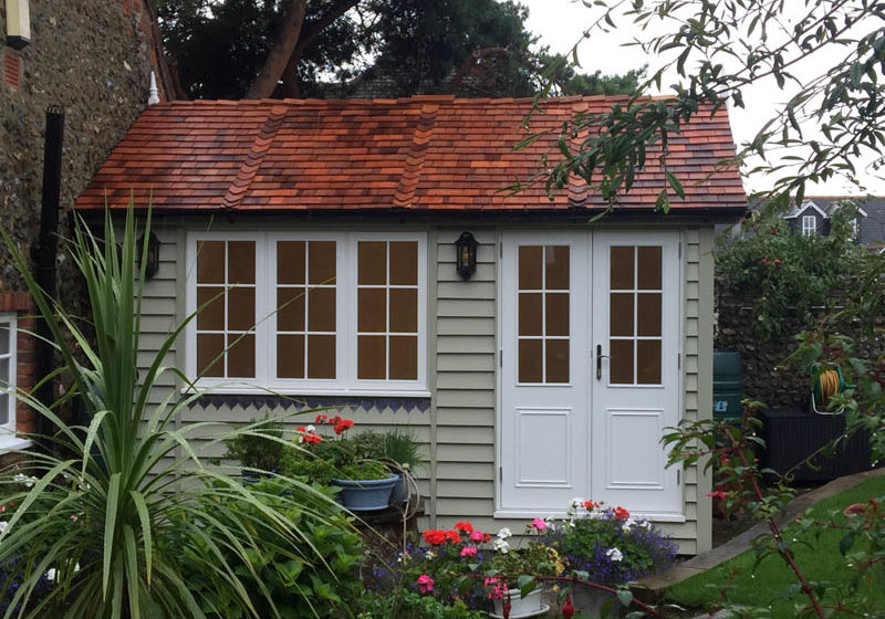 A beautifully tiled cedar shingle roof and traditional detailing
