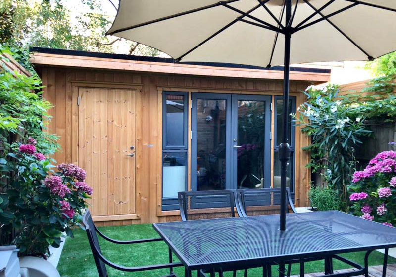 Garden room with the back wall forming the garden fence