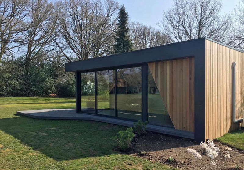 Large garden office and guest bedroom by Swift Garden Rooms