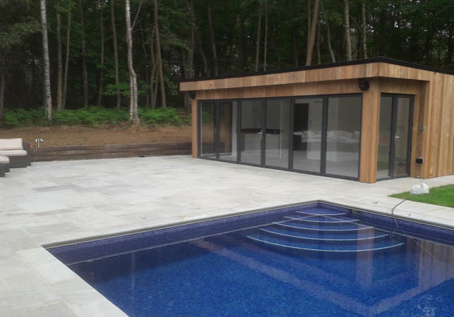 Contemporary style pool house by Bathstone Garden Rooms